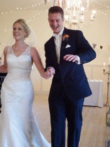 A happy couple at a wedding officiated by Peter Tautz - the Right Toastmaster